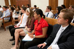 Thumbnail for Interns listening to a speaker